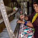 A women weaving Dhaka fabric at Tansen, Palpa
