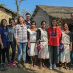 Guest posing with the Hosts at Barauli Community Homestay